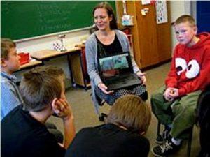 laptop and teacher